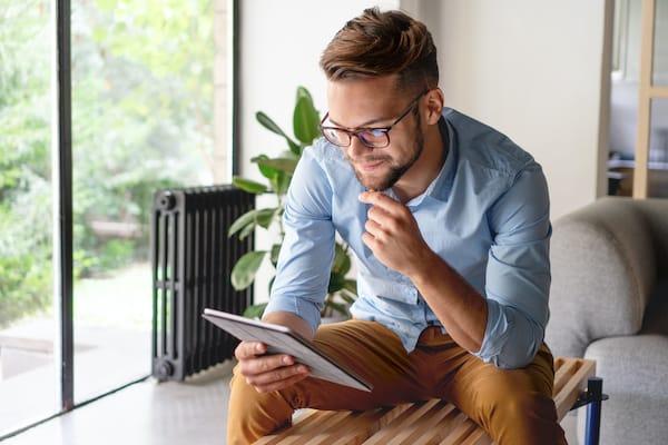 Man reading from ipad